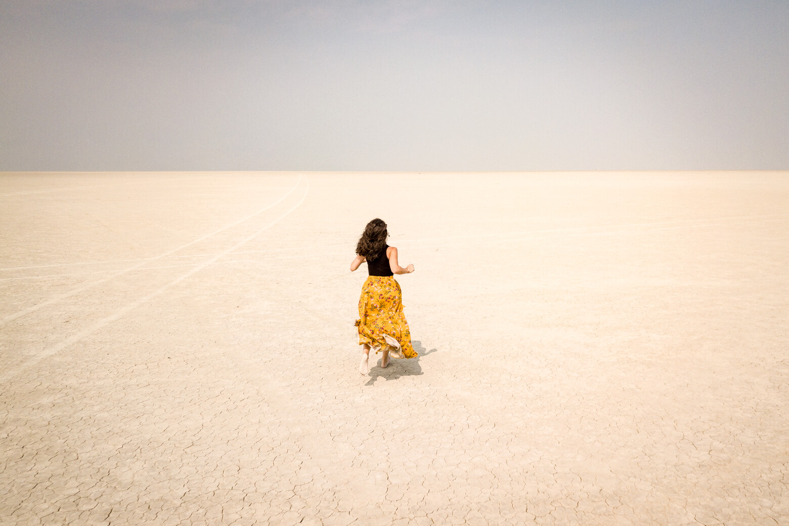Women running in Alvord Desert