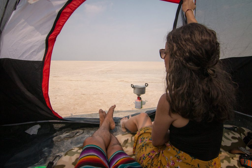 Woman sitting in a tent in Alvord Desert.