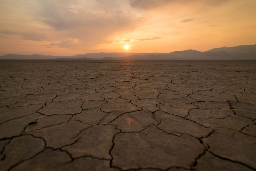The sun setting over the Steen Mountains in the Alvord Desert.