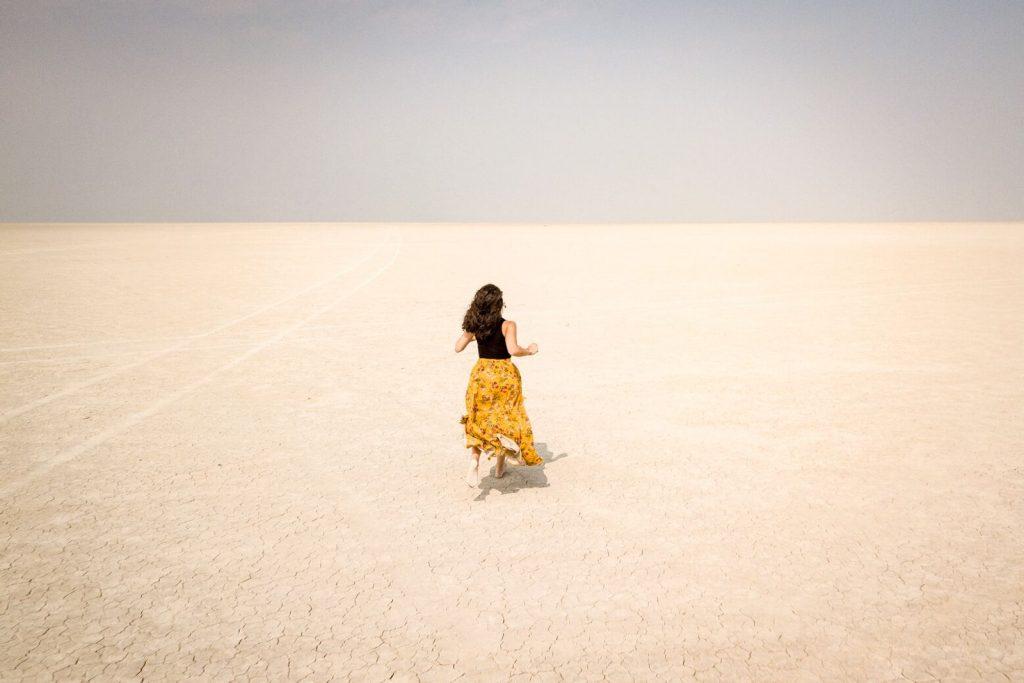 Nina running in the Alvord Desert in Oregon