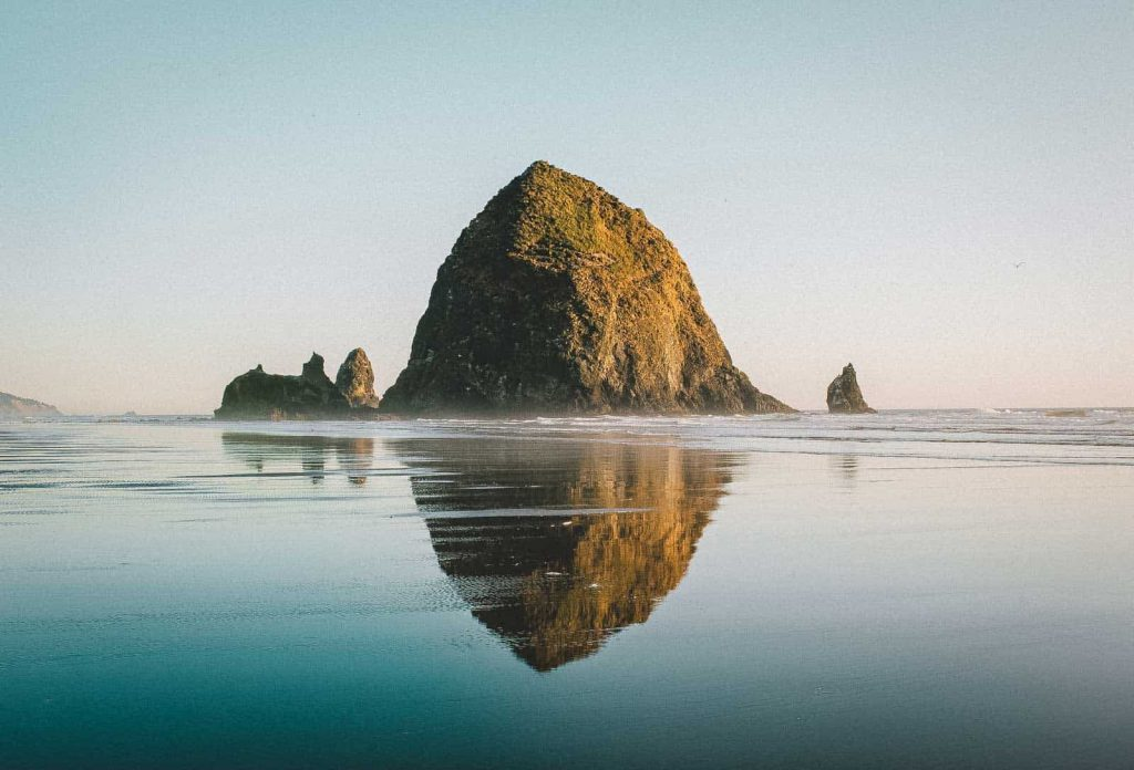 Haystack Rock and reflection at Cannon Beach, one of the most beautiful places in Oregon