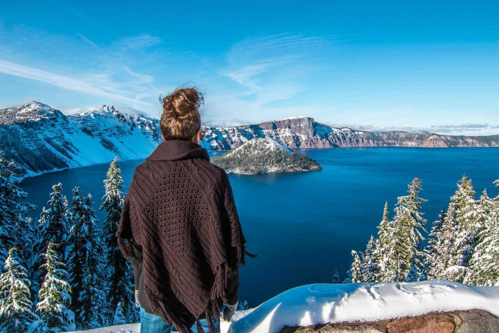 Nina looking out over Crater Lake in Winter