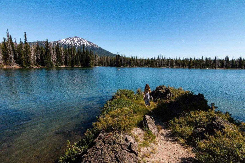 Nina looking over lake in Cascade Lake region of Oregon