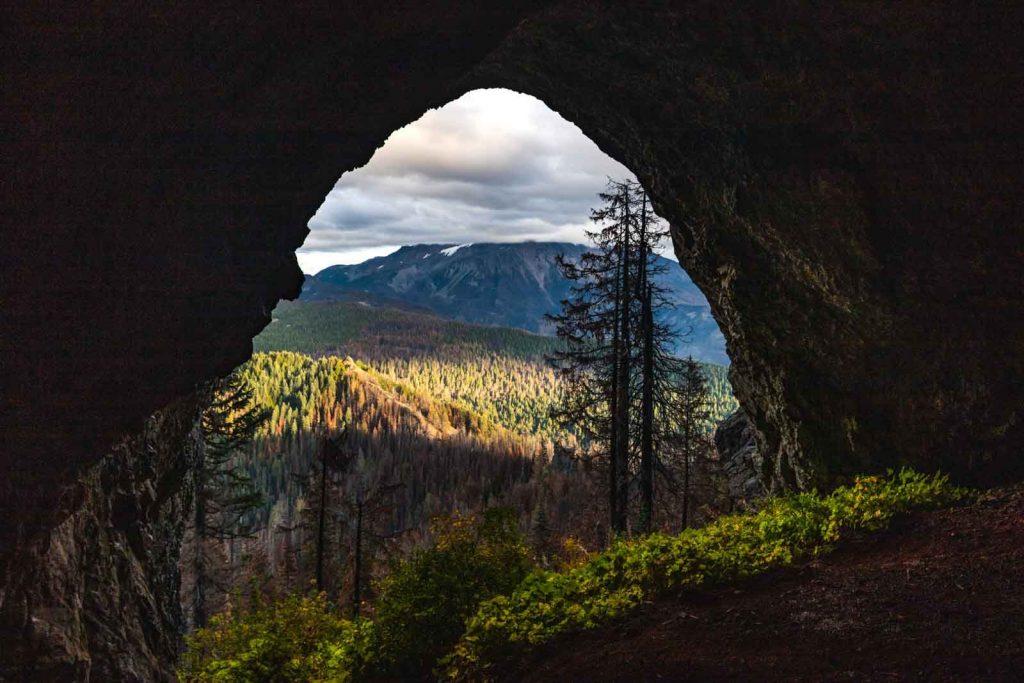 Triangulation peak view through cave entrance