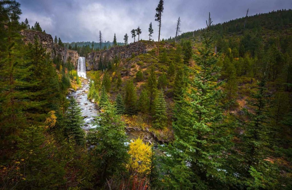 View over forest to Tumalo Falls, one of the most beautiful places in Oregon