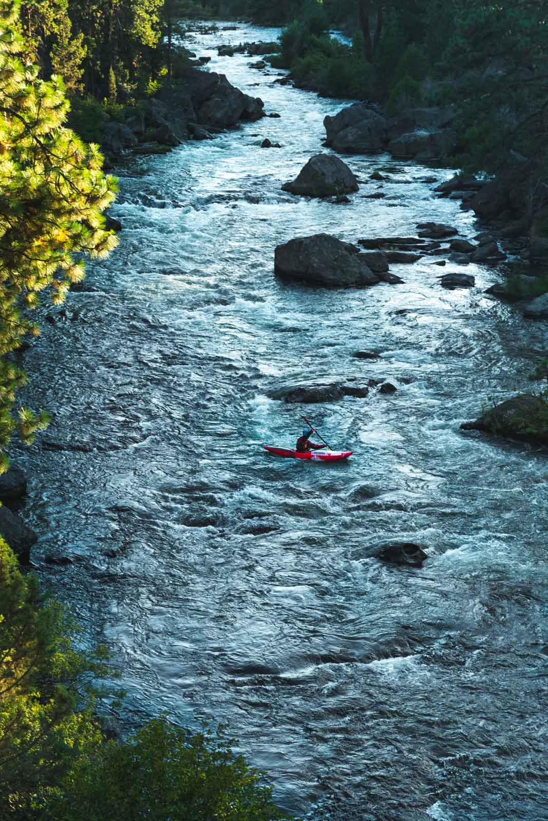 Person kayaking the Deschutes River
