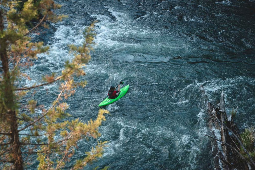 A view of people white water rafting on the Deschutes River — one of several exciting things to do in Bend