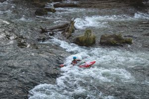 Kayaker on the Deschutes River — just one of the many beautiful things to do in Bend
