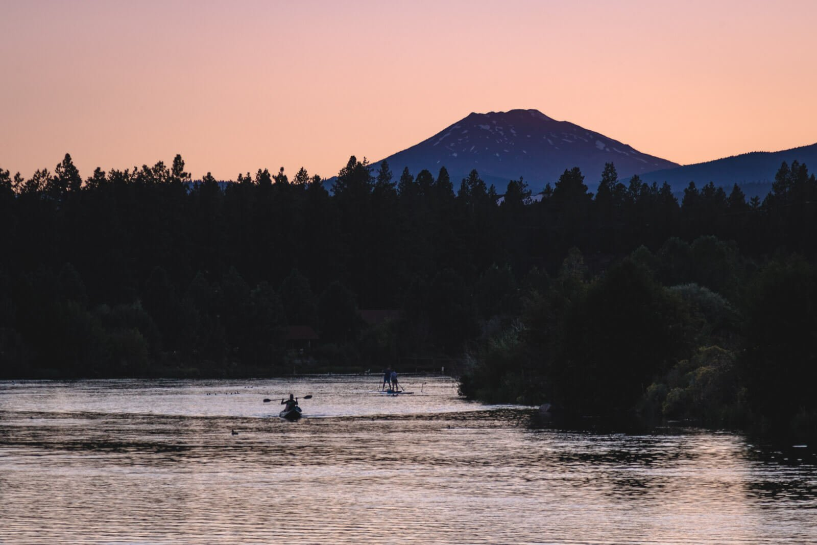 Kayakers on the Deschutes River — add this to your list if you're wondering what to do in Bend