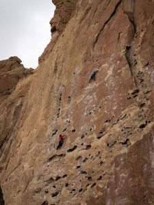 People rock climbing on Smith Rock — add this to your list if you're wondering what to do in Bend
