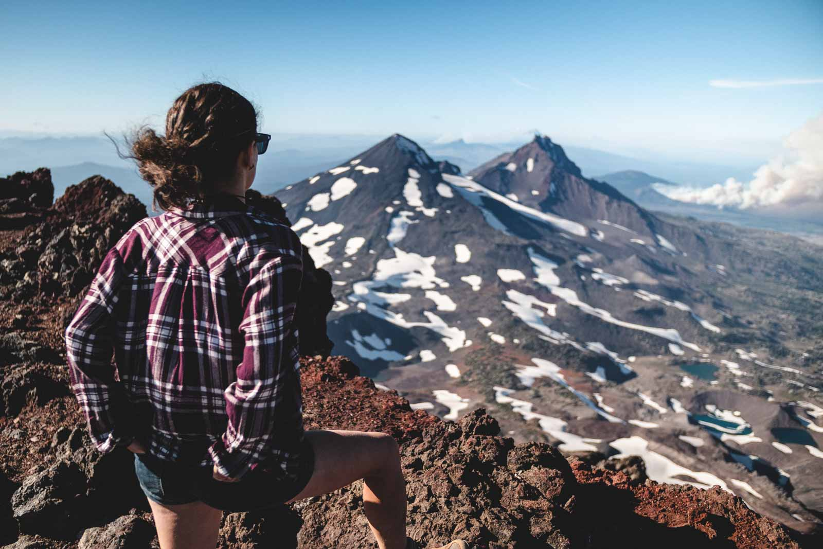 Me looking at a mountain top in Bend — a picturesque thing to do in Bend