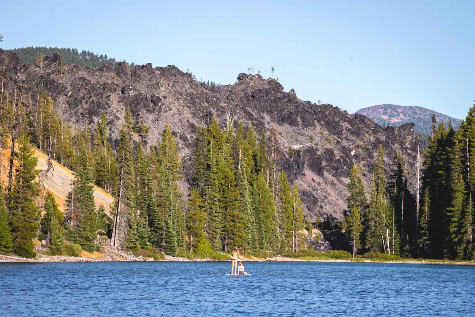 Paddle boarding is a fun activity to do in Devils Lake near Cascade Lakes.