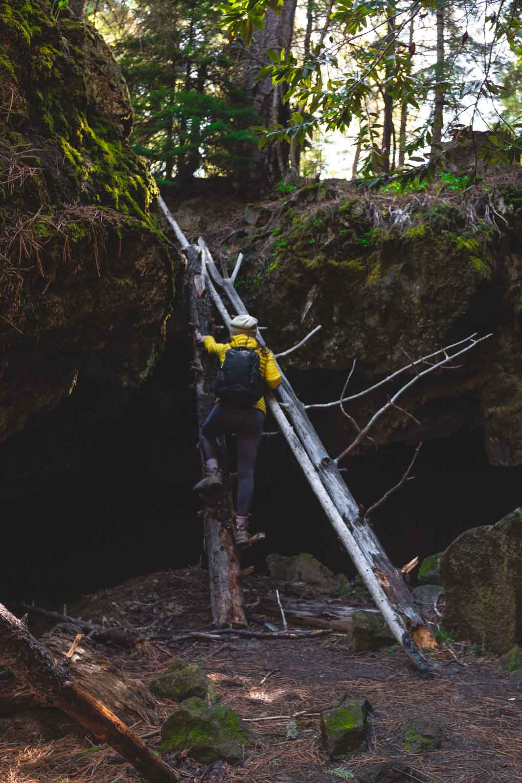 Climbing into Skylight Cave in Oregon