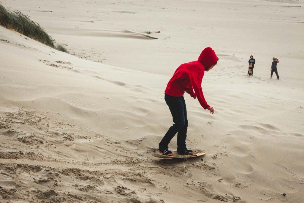 Sandboarding is fun in the Oregon sand dunes!