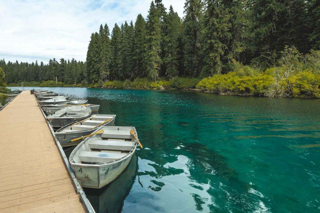 Boats docked along pier at Clear Lake Oregon