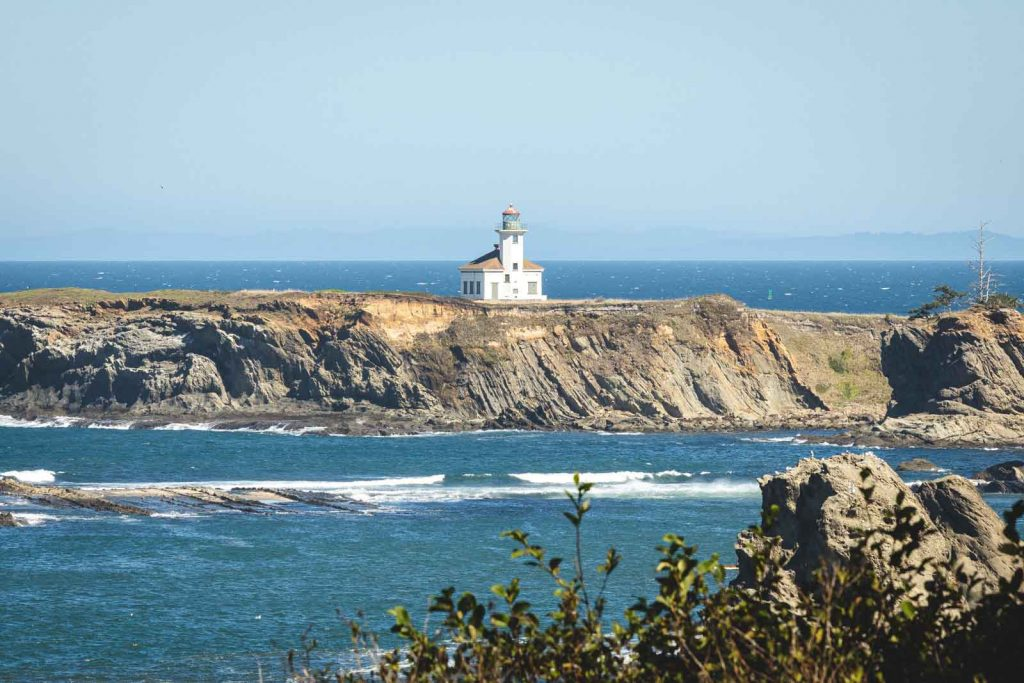 View across bay to Cape Argo Lighthouse, one of the best Oregon Lighthouses