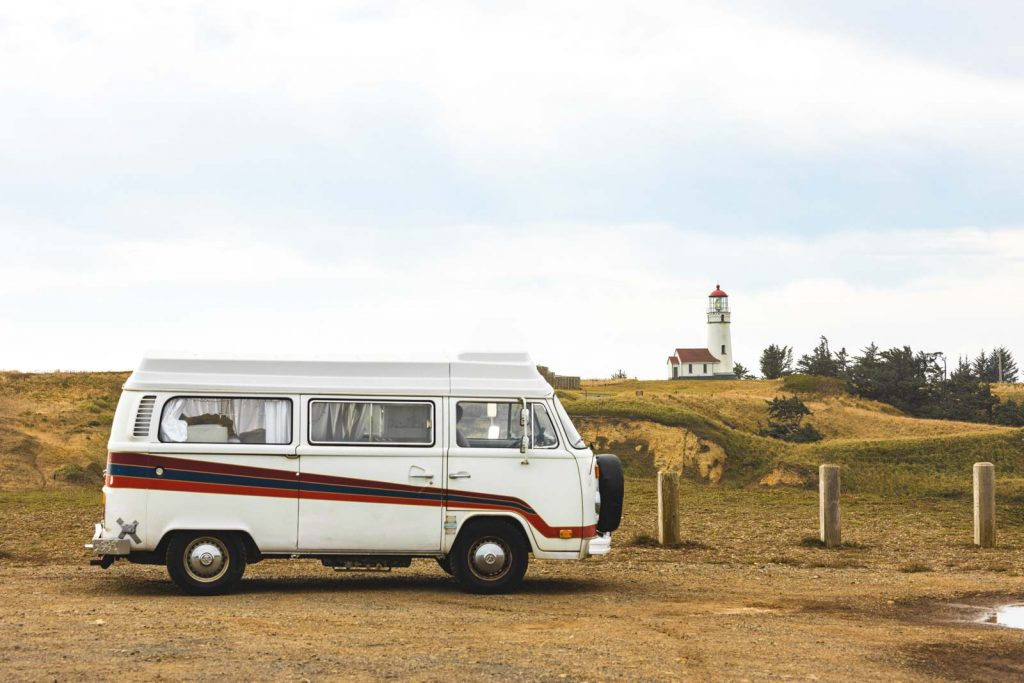 Van parked in foreground of Cape Blanco Lighthouse, a must visit Oregon Lighthouse