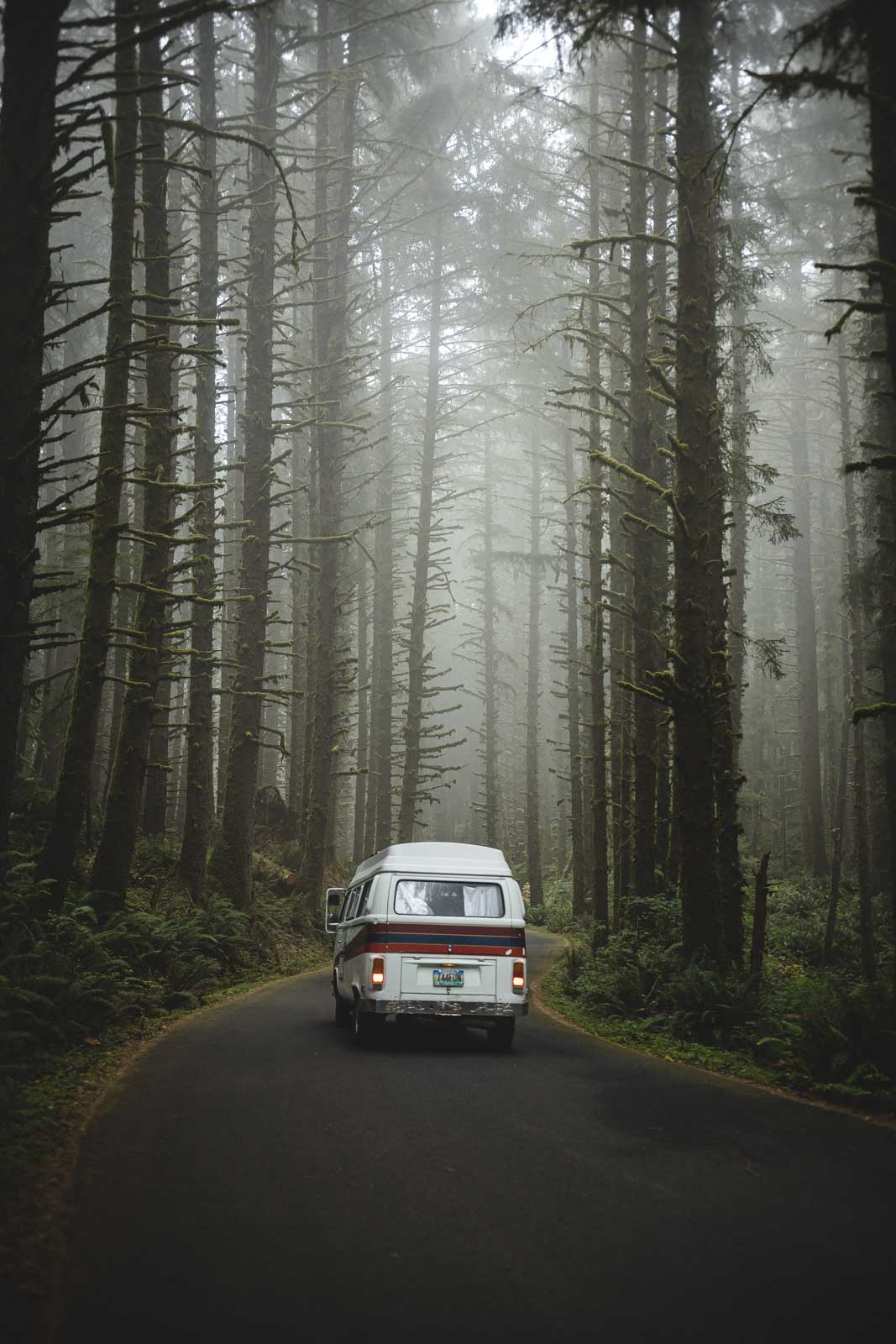 VW van on road in the forest at Ecola State Park, one of the Oregon Coast State Parks