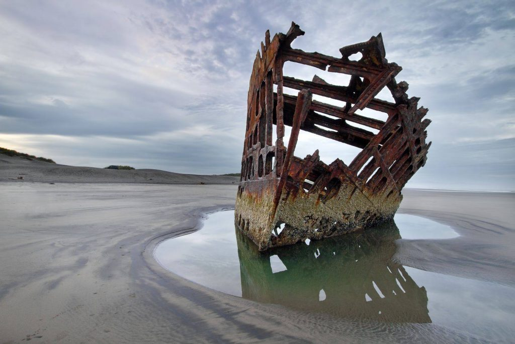 Ship wreck on beach at Fort Stevens State Park, one of the best Oregon Coast State Parks