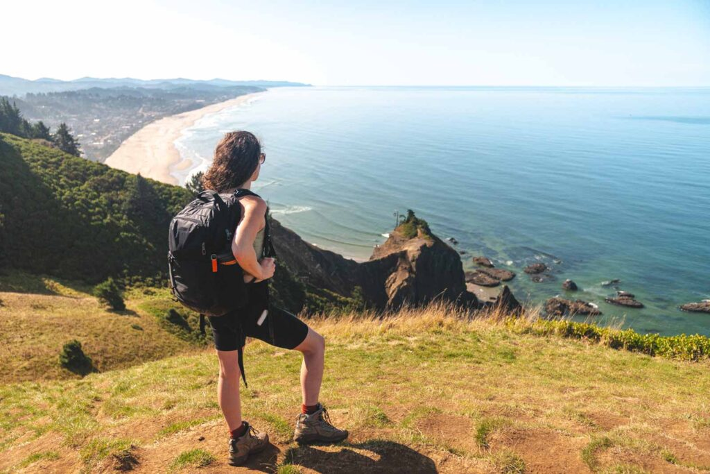 Woman looking out at view of ocean from God's Thumb hike