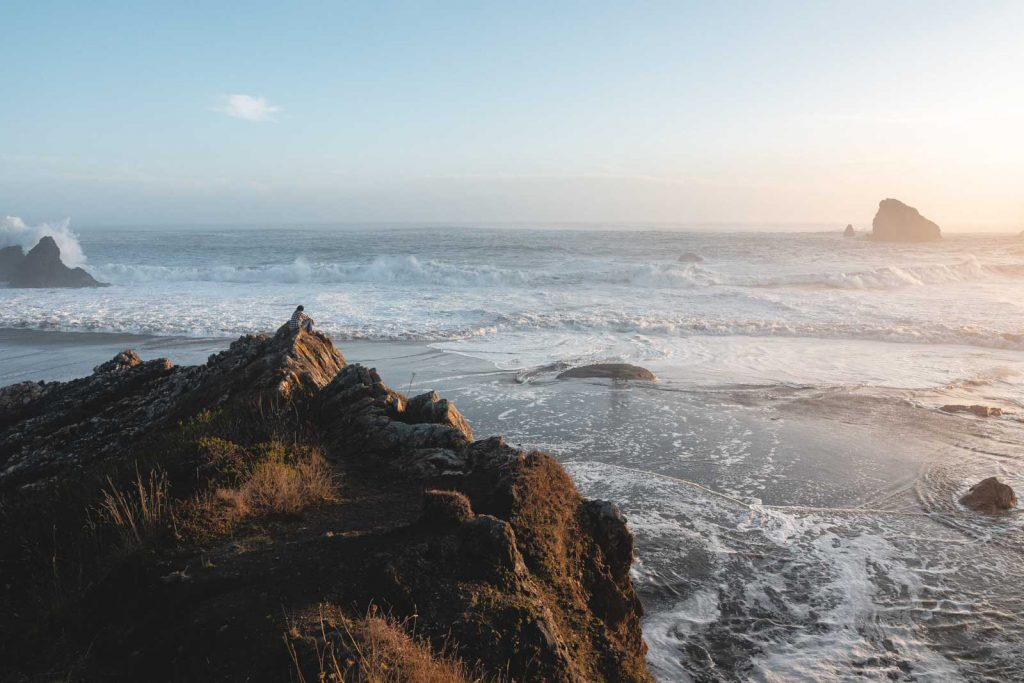 View out to ocean with rocky coastline in the foreground at Harris Beach State Park on the Oregon Coast