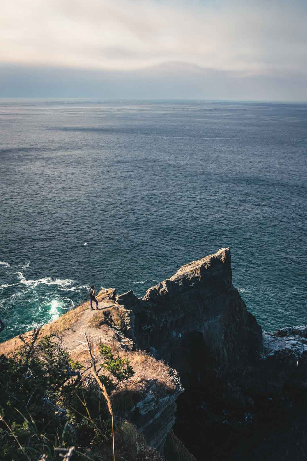 View of ocean and rocks from clifftop on the Cape Falcon trail