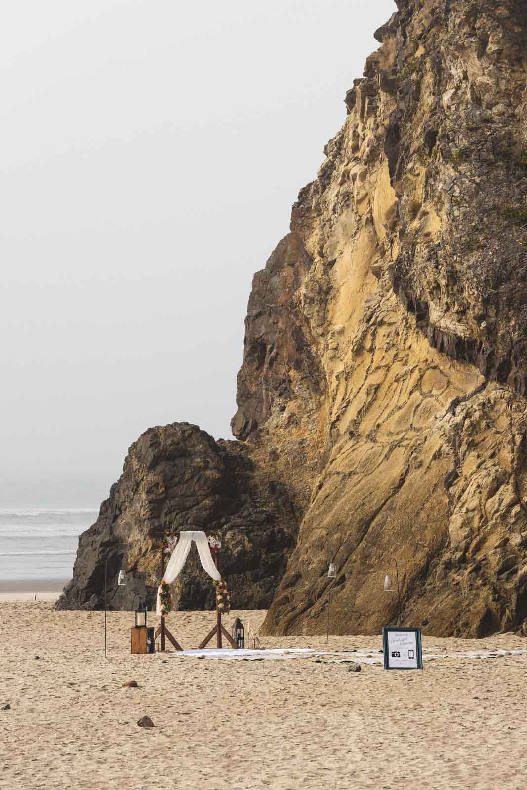 Wedding setup on the beach in front of sea cliffs at Hug Point State Park, one of the Oregon Coast State Parks