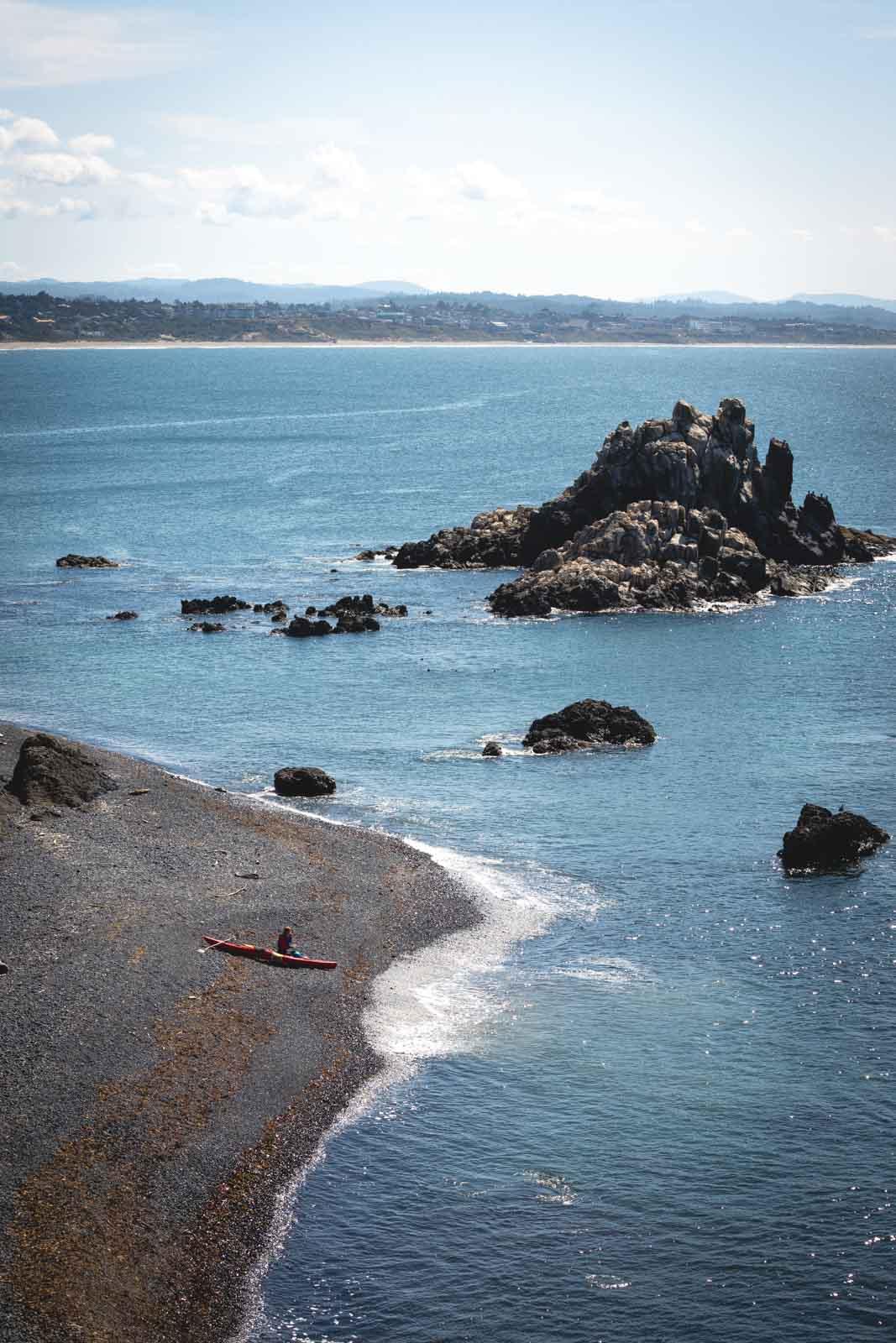 Kayaker on beach near Yaquina Head Oregon Lighthouse