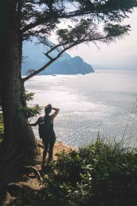 Hiker looking out to the ocean on the Cape Falcon Trail