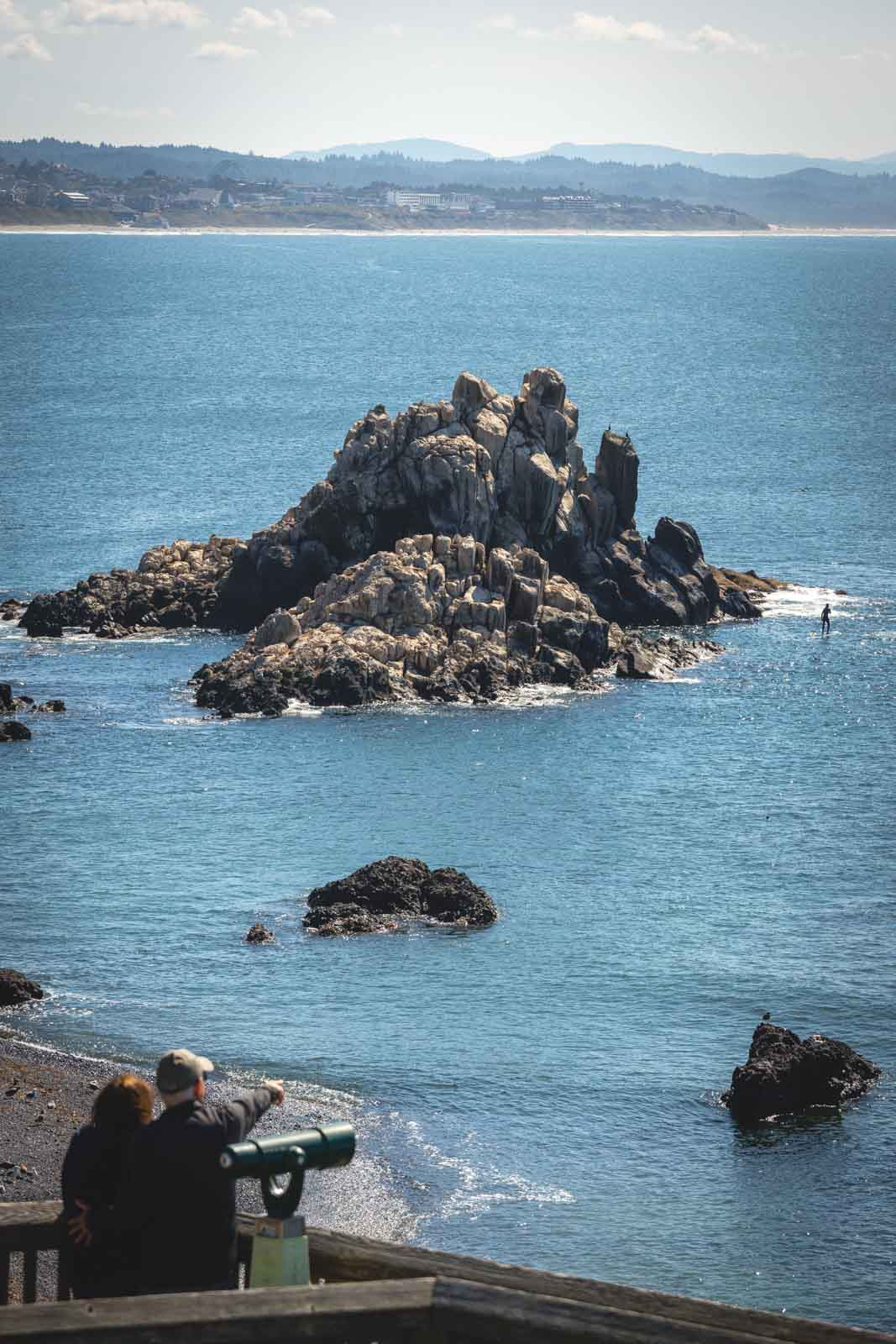 View of ocean with rocky islands in Yaquina Bay, one of the Oregon Coast State Parks