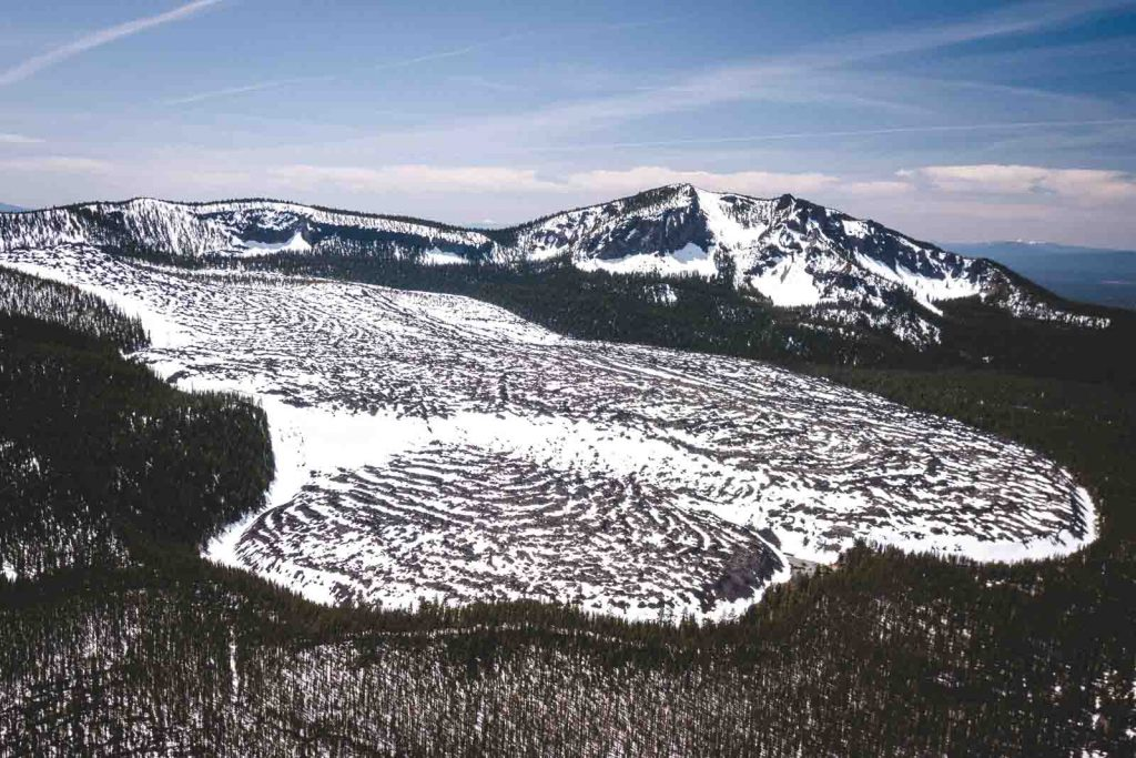 Old lava flow with snow on it at Newberry National Volcanic Monument