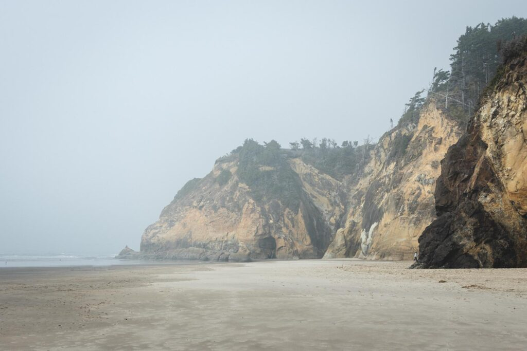 Sea cliffs and foggy beach at Hug Point