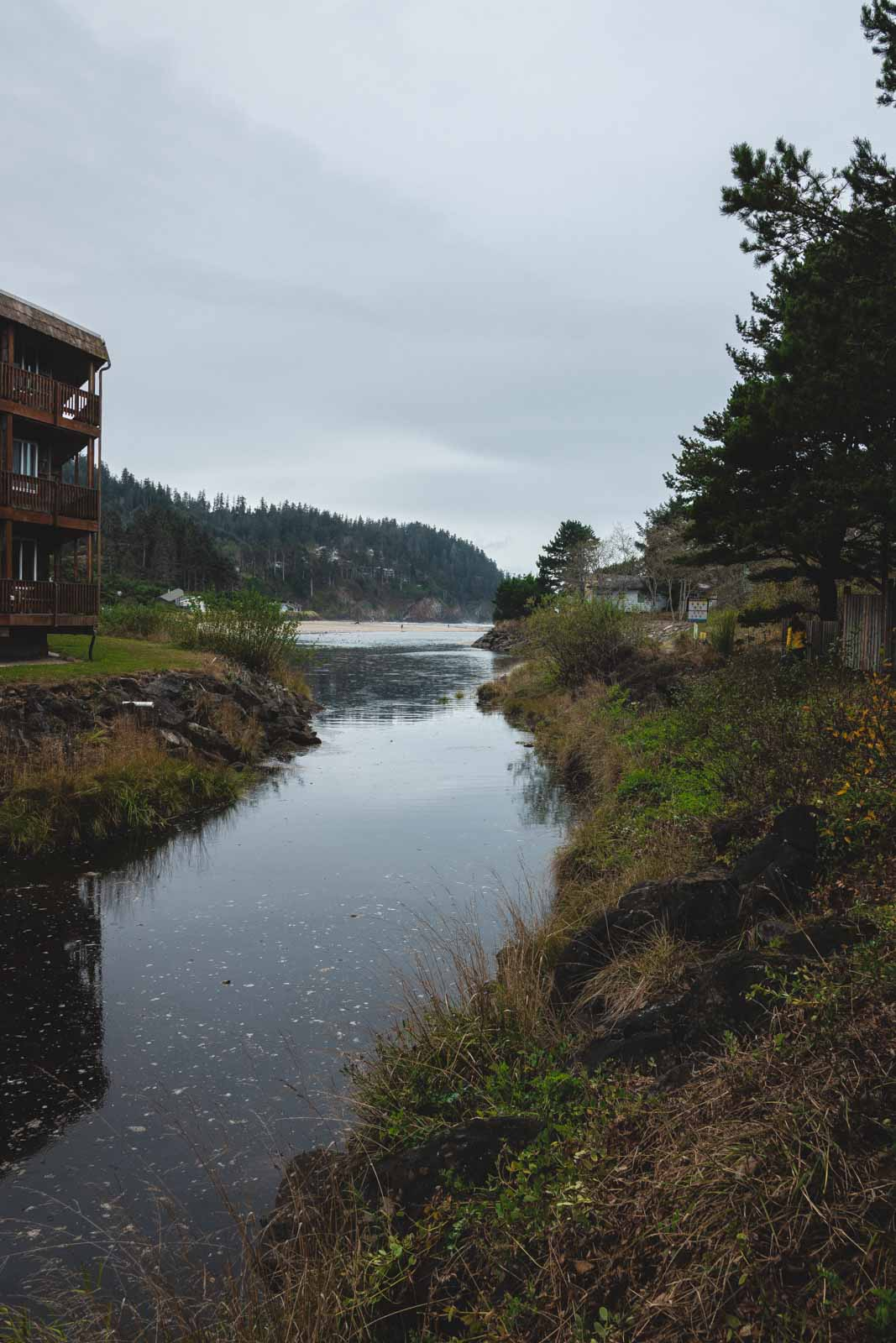 Stream with building on the banks at Neskowin Beach, one of the best beaches on the Oregon Coast