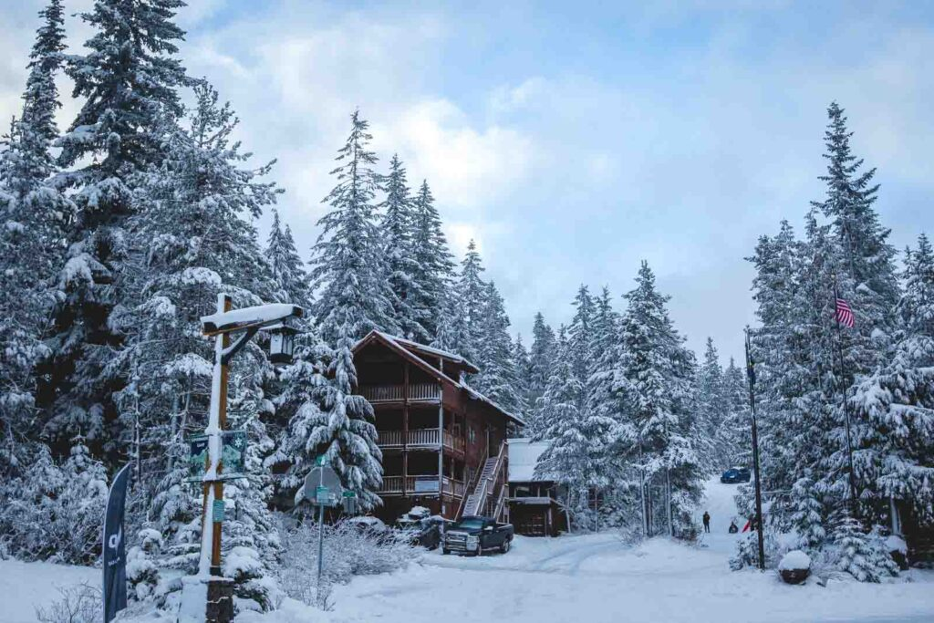 Building surrounded by snow and trees at Summit Ski Area in Oregon
