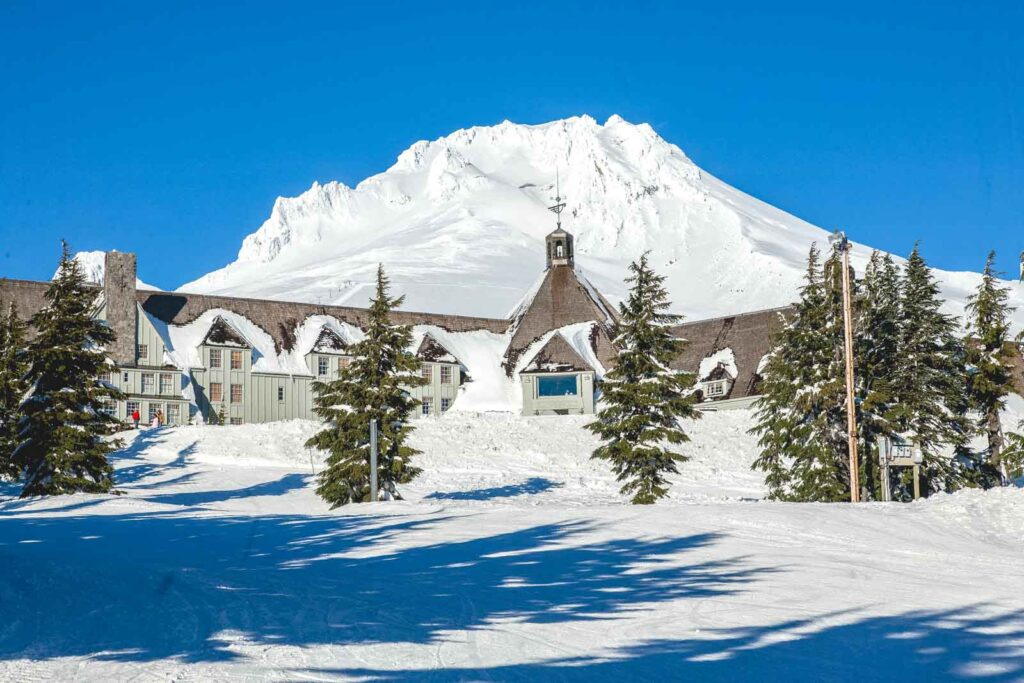 Timberline Ski Resort covered in snow with Mount Hood in the background at Timberline Ski Resort in Oregon
