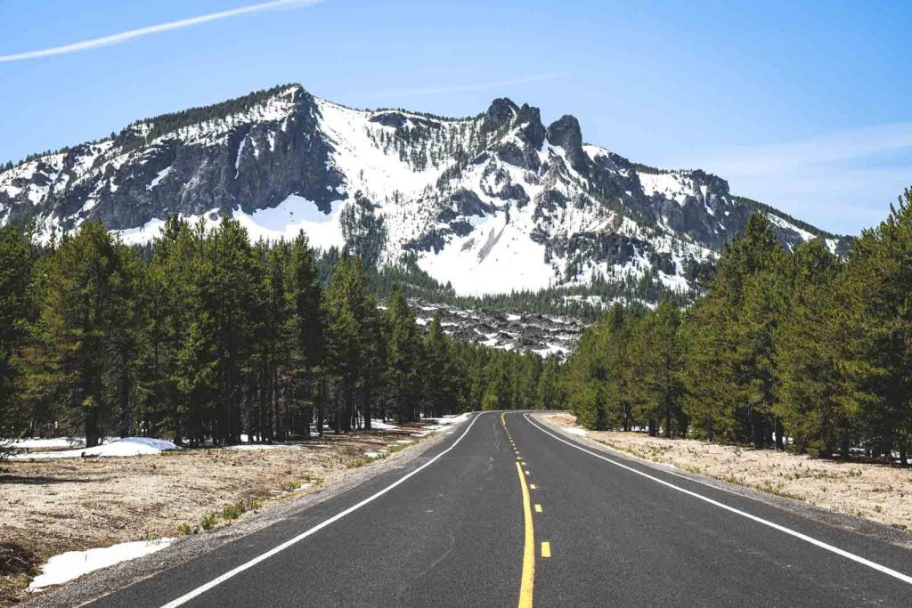 Road with view of forest and Paulina Peak in Newberry National Volcanic Monument
