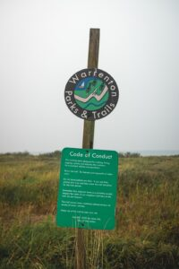 Sign for Airport Dike trail, one of the best things to do in Astoria Oregon