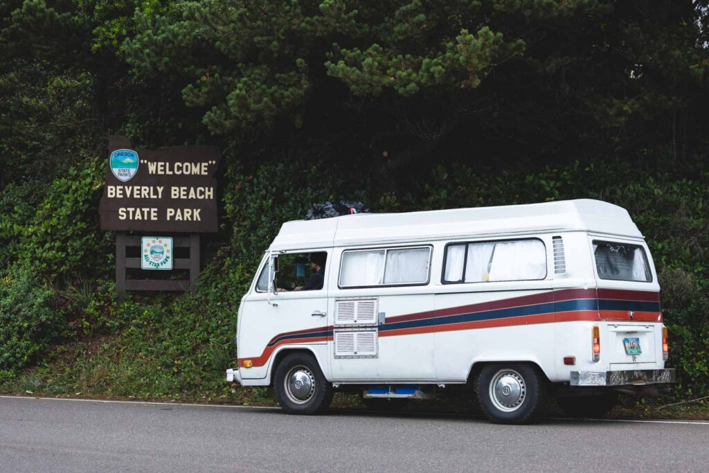 VW van beside sign for Beverly Beach State Park