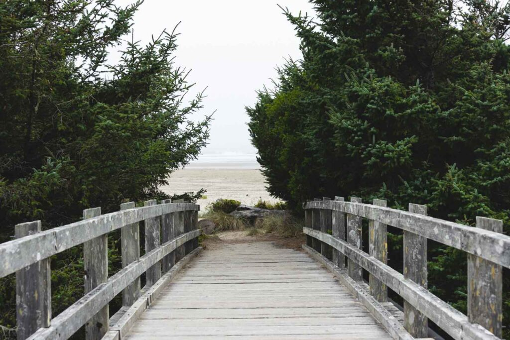 Bridge leading to beach in Brian Booth State Park - one of the best things to do in Newport Oregon