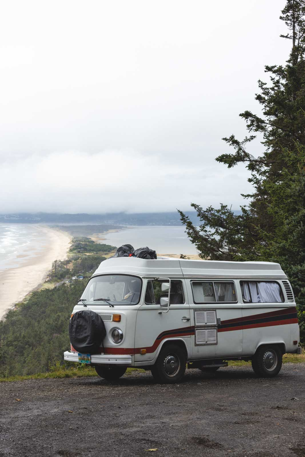 VW van in front of view of Cape Lookout State Park beach