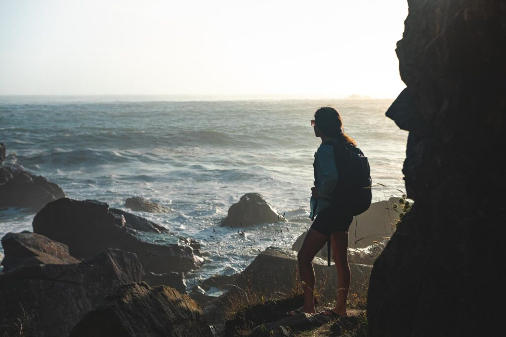 Two people looking out at the ocean at Harris Beach State Park in Oregon