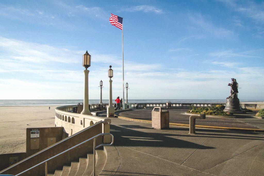American flag and lamp posts on beach promenade in Seaside, Oregon