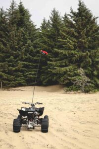 4x4 ATV on sand with forest in background at William Tugman State Park in Oregon