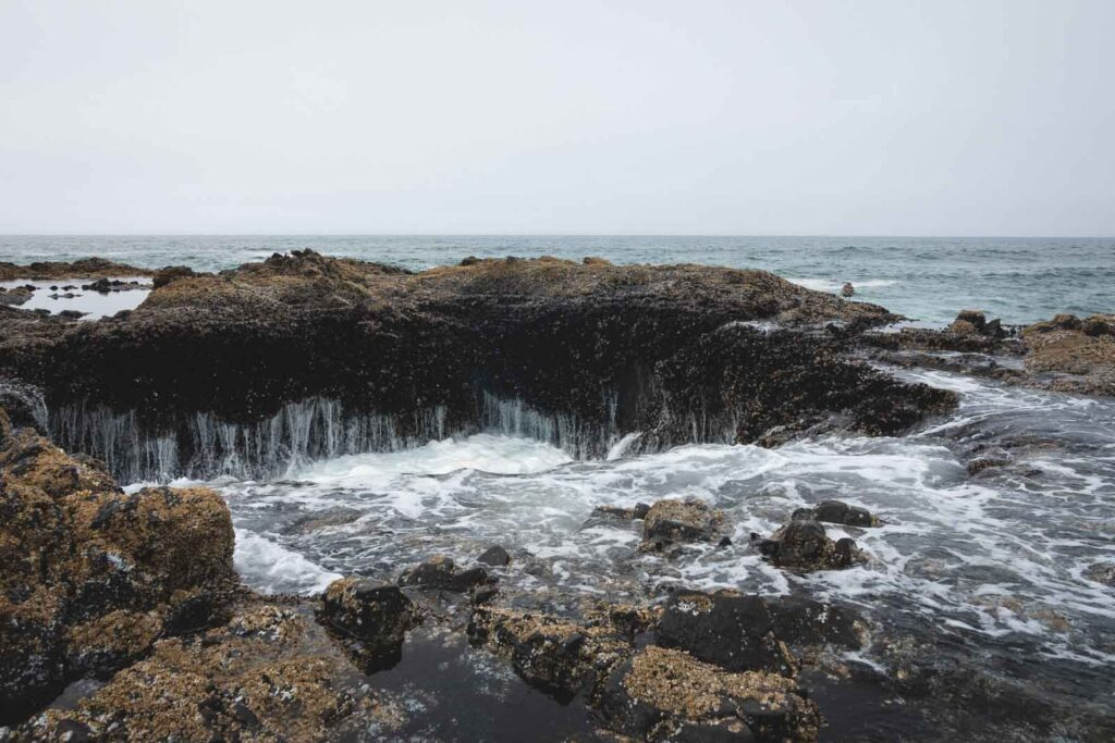Close up shot of Thor's Well - a rocky cauldron in the ocean