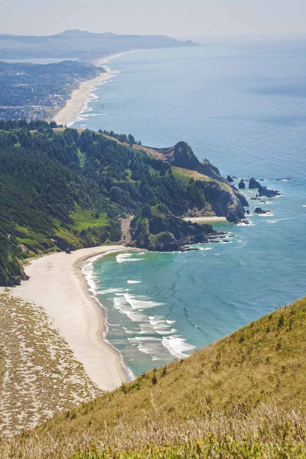 Aerial view over beach, ocean and headland from Harts Cove trail near Lincoln City