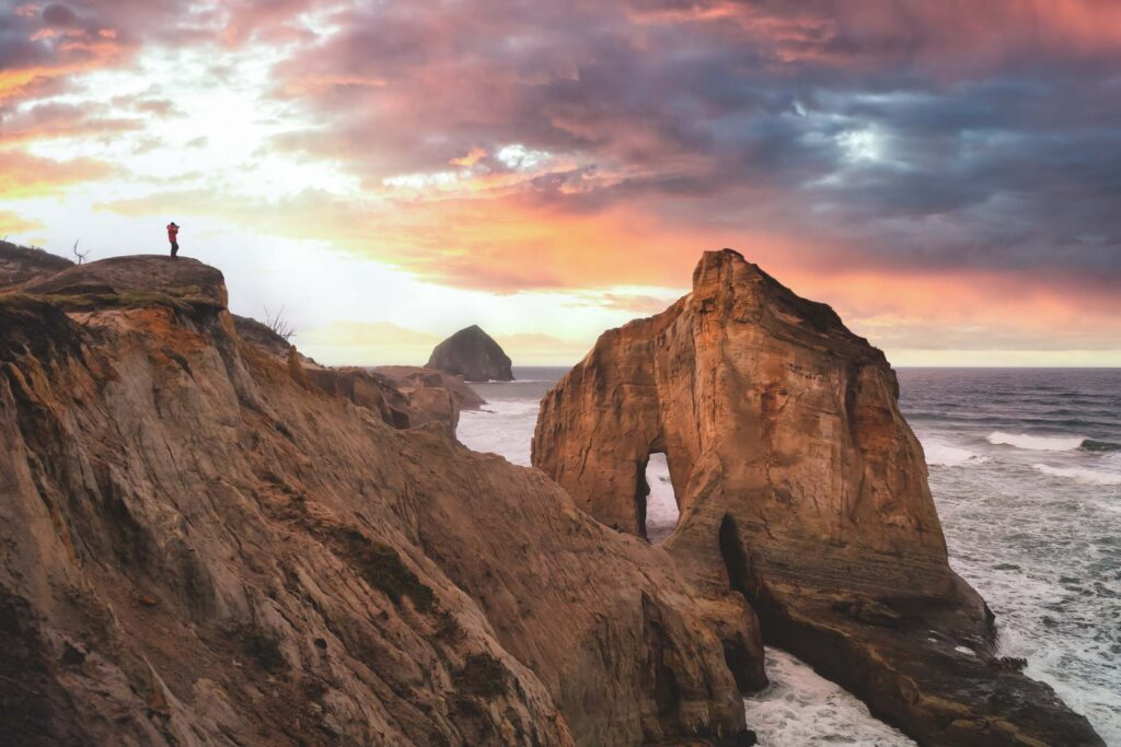 View of ocean and rocky islands and outcrops at sunset at Cape Kiwanda near Pacific City