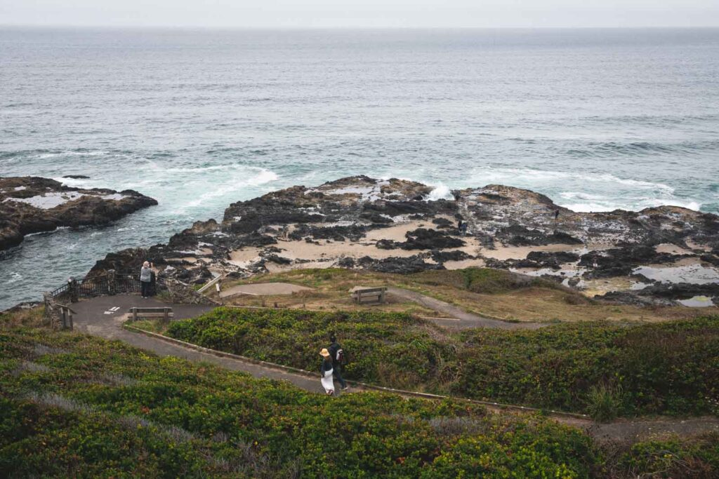 View over Thor's Well, ocean and grassy area from parking lot