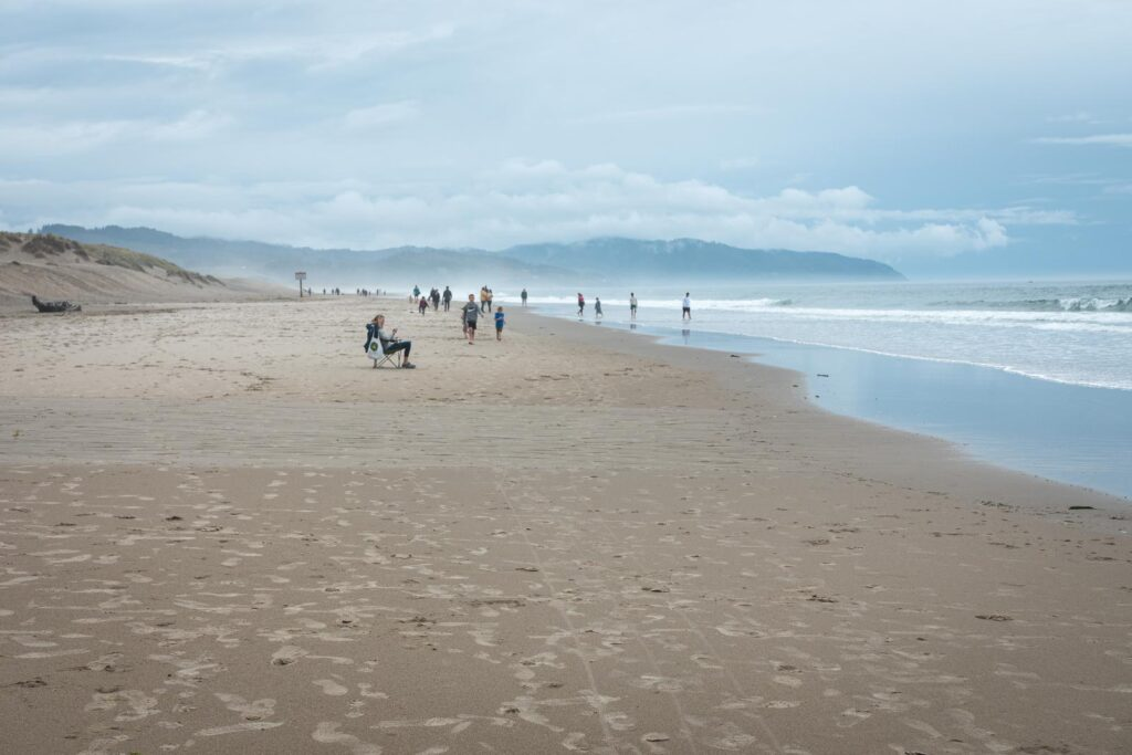 Winema Beach on overcast day with people walking on it.
