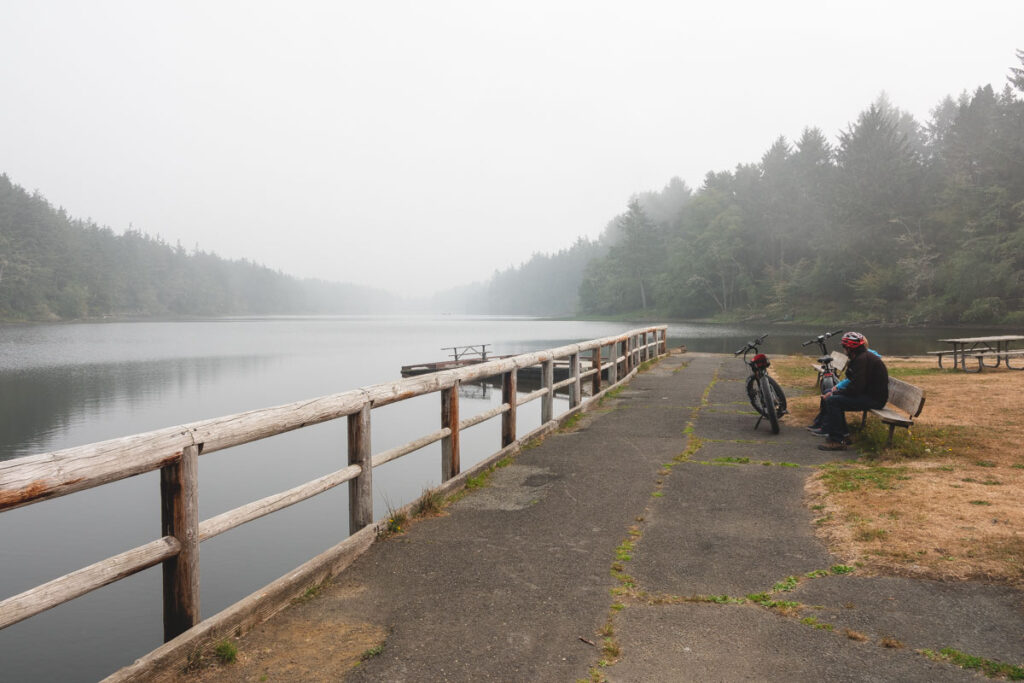 Two bikes on paved trail by Coffenbury Lake in Fort Stevens State Park