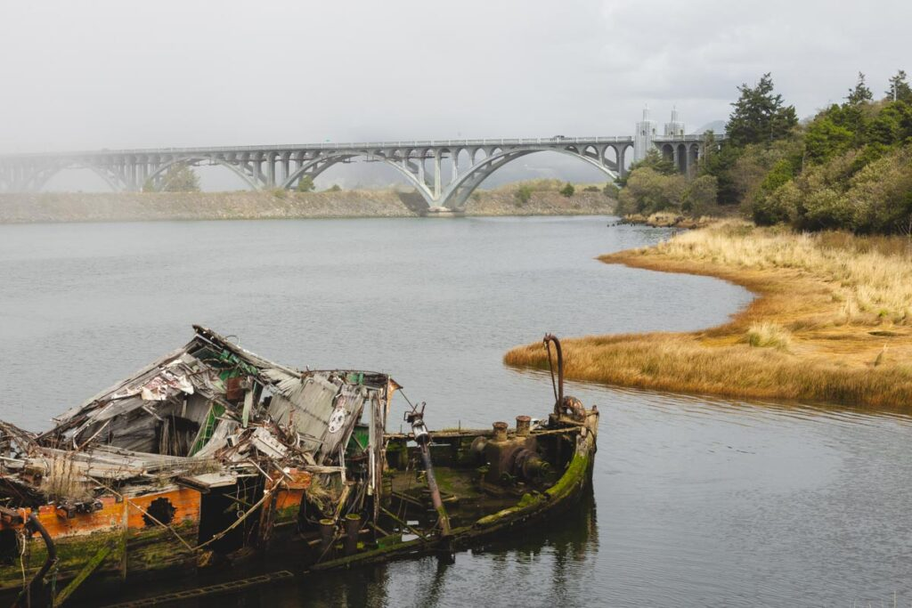 Mary D Hume shipwreck in water with bridge in background at Gold Beach Oregon